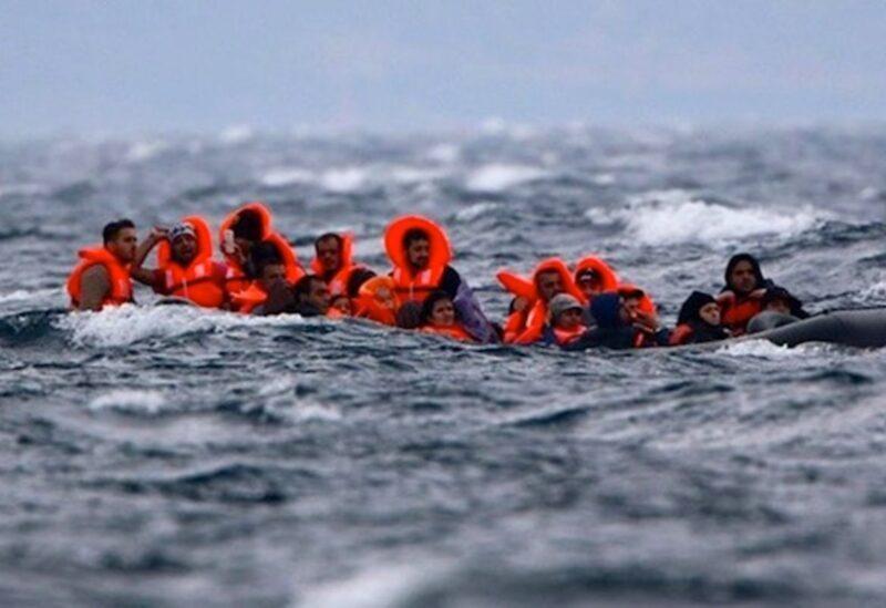 Des migrants en mer-Archive